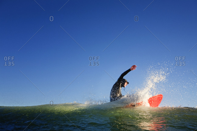 Man surfing crest of wave