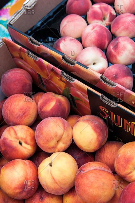 Ripe peaches in boxes
