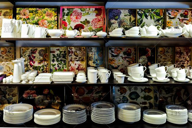 Stacked ceramic dishware on shelves