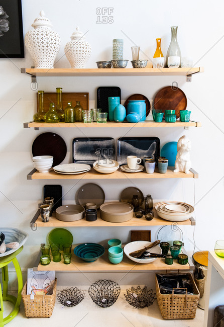 Various dishware on display in a store