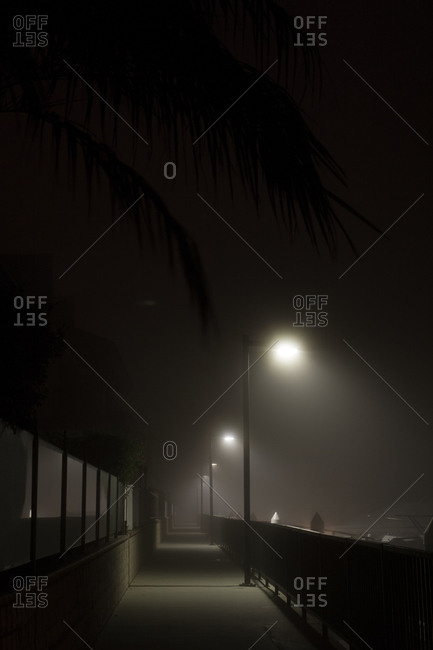 Lampposts illuminating a street at night