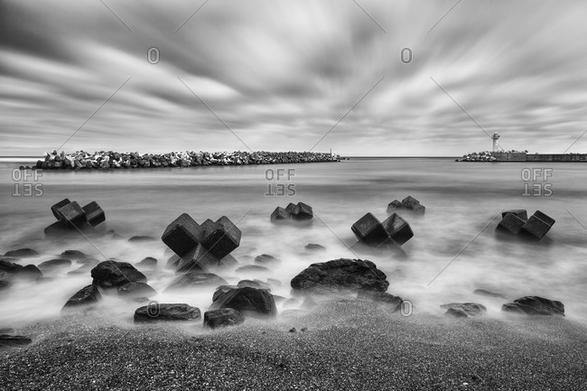 Tetrapods on rocky Japanese coastline