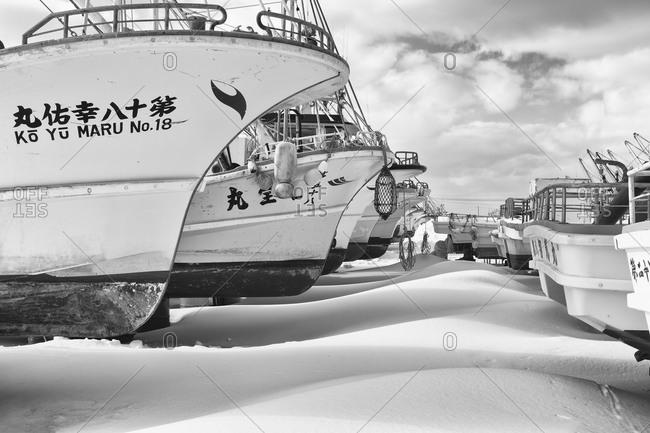 Hokkaido, Japan - January 14, 2015: Boats grounded for winter in Japan