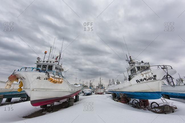 Hokkaido, Japan - January 15, 2015: Sailboats moored for winter in Japan