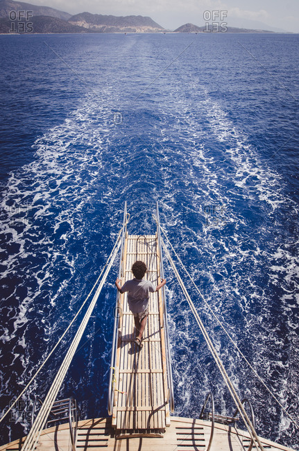 Boy on boat on Mediterranean sea in Turkey