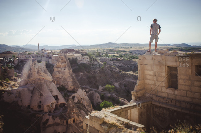 Man overlooking ruins of Cappadocia, Turkey