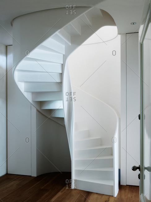 White staircase in a hall