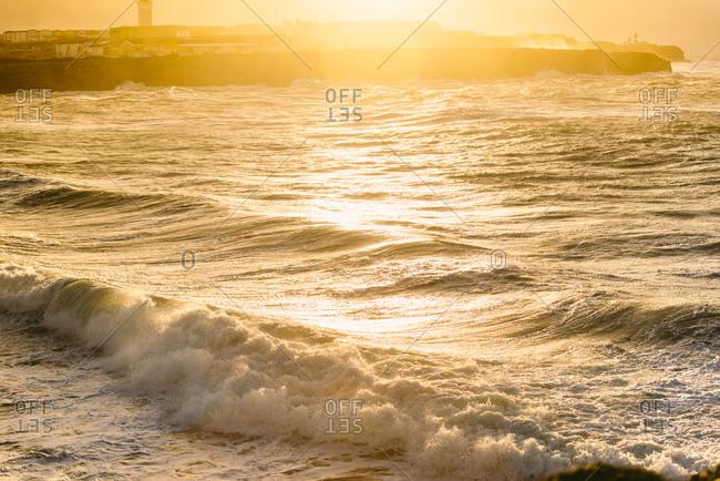Ocean waves breaking on the shore in Peniche, Portugal