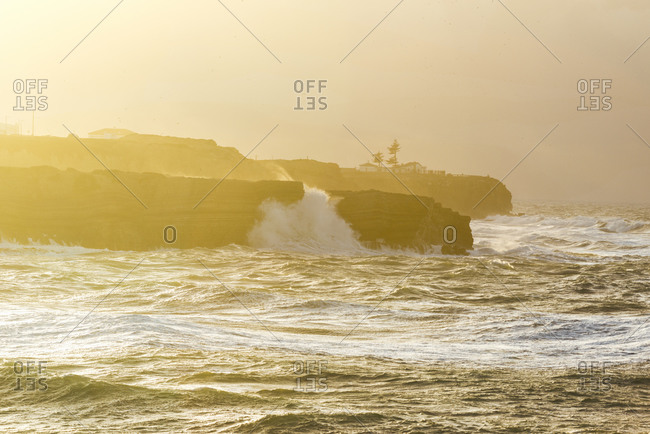 Waves breaking on the shore in Peniche, Portugal