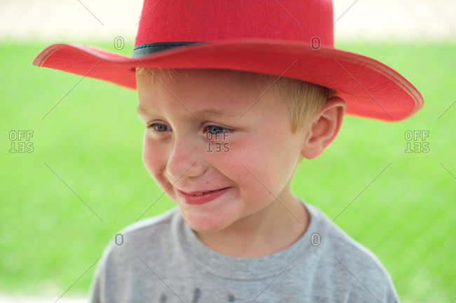 A boy in a red cowboy hat on the Fourth of July