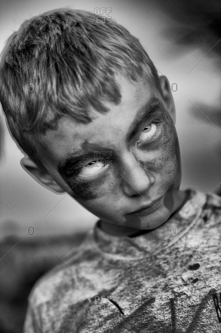 A little boy dressed up like a zombie