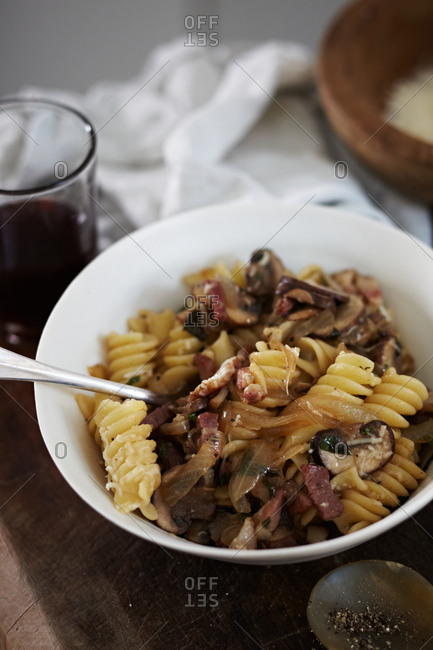 A bowl of hearty pasta with mushrooms and bacon