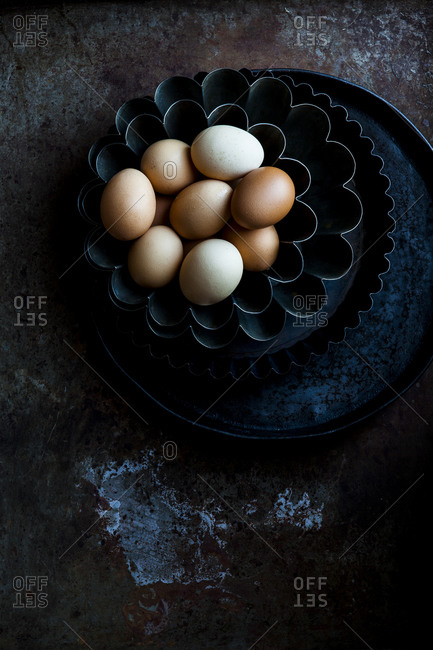 Fresh eggs in vintage baking tins