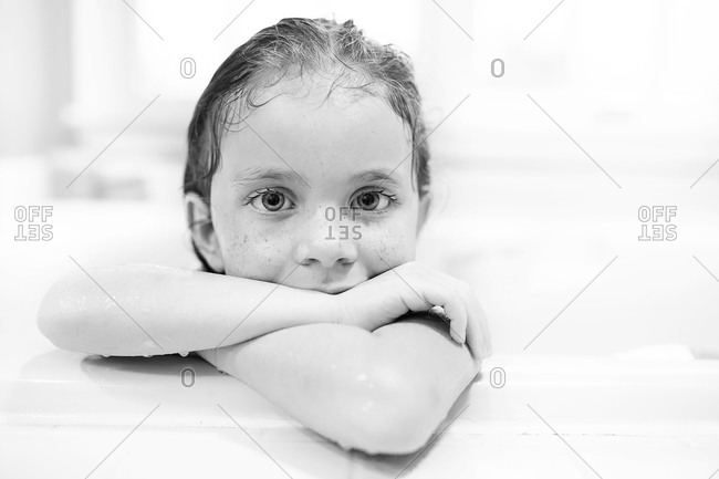 Young girl leaning on a bathtub