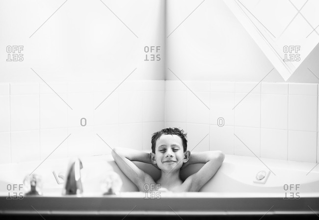 Young boy relaxing in a bathtub