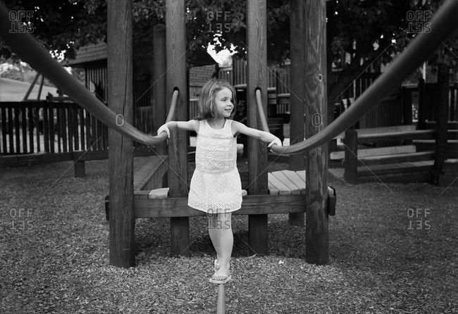 Young girl balancing in a playground