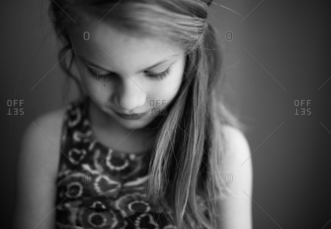 Portrait of a young girl looking down