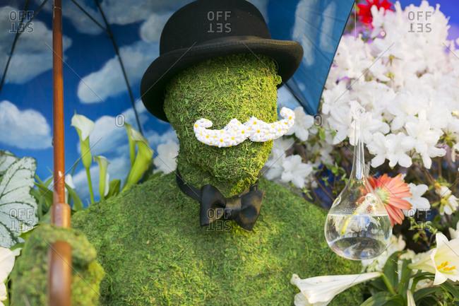 NY, NY, USA - April 4, 2015: Decoration of a grass man with floral mustache in New York City, NY, USA