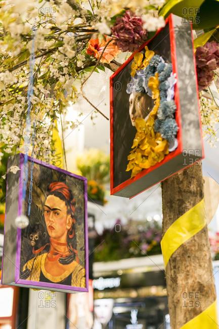 NY, NY, USA - April 4, 2015: Paintings hanging from a tree in New York City, NY, USA