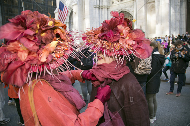 NY, NY, USA - April 4, 2015: Women wearing floral hats at the Easter Parade in New York City