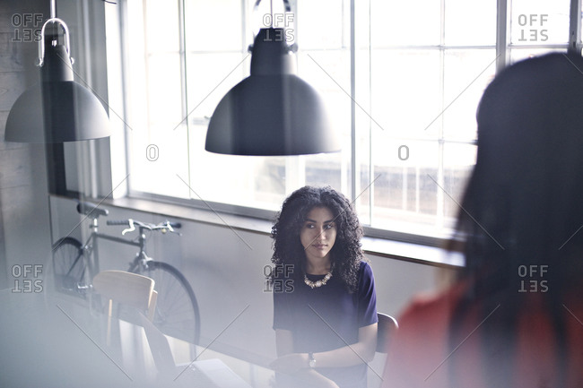 Brunette woman during a meeting