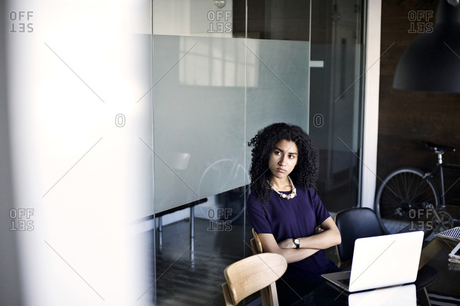 Young woman sitting at a meeting