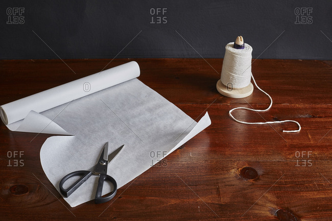 Scissors, parchment paper and string