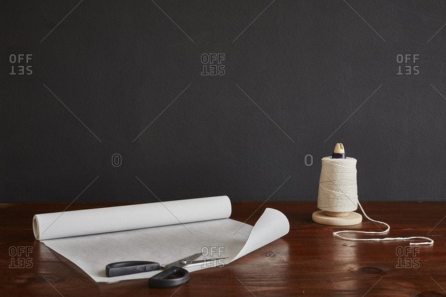 Scissors, parchment paper, string