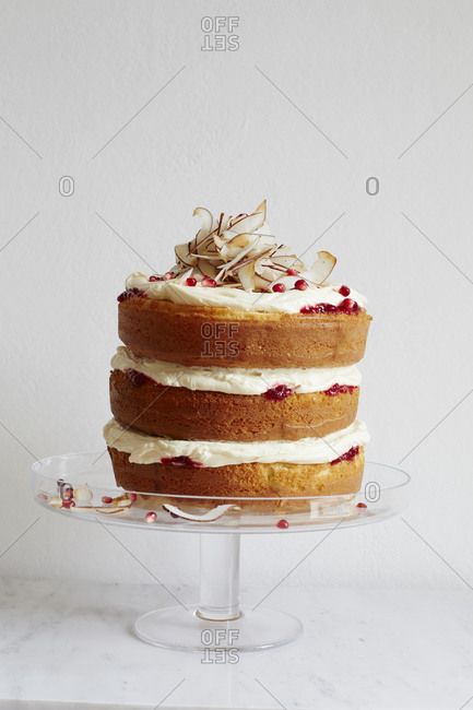Layered cake with coconut shavings and pomegranate seeds