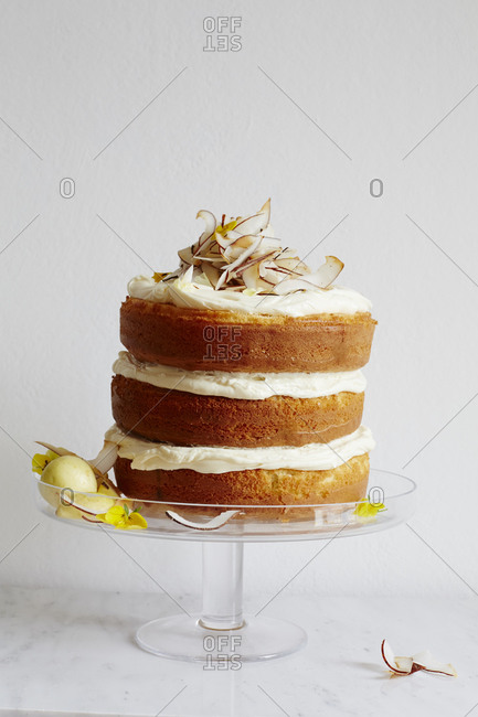 Layered cake with frosting and coconut shavings