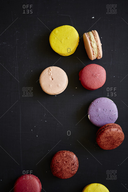 Several macarons on gray background