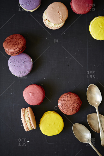 Several macarons and silver spoons