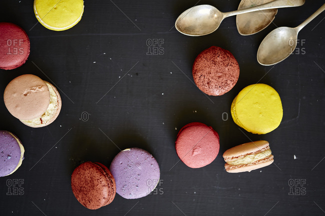 Several macarons and tarnished spoons