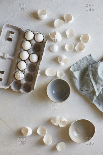 Eggs and eggshells by bowls