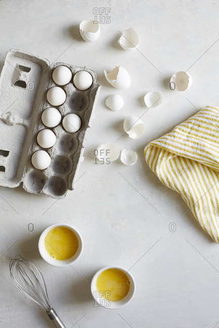 Eggshells and bowls of whisked eggs