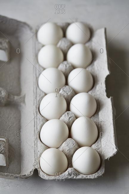 A dozen eggs in carton