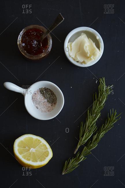 Chicken rub ingredients on gray background
