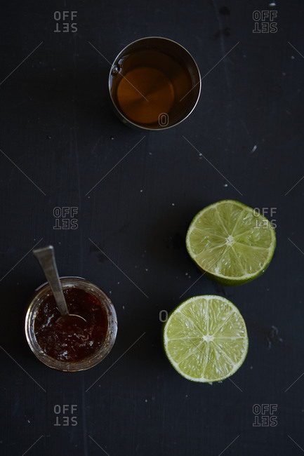 Rum cocktail ingredients on gray background