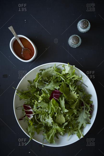 Light salad with vinaigrette, salt, pepper