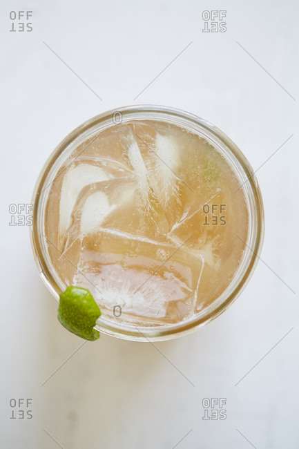 Light cocktail in glass from above