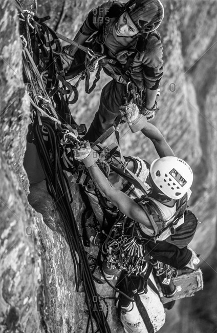 Team of women rock  climbers on a big wall