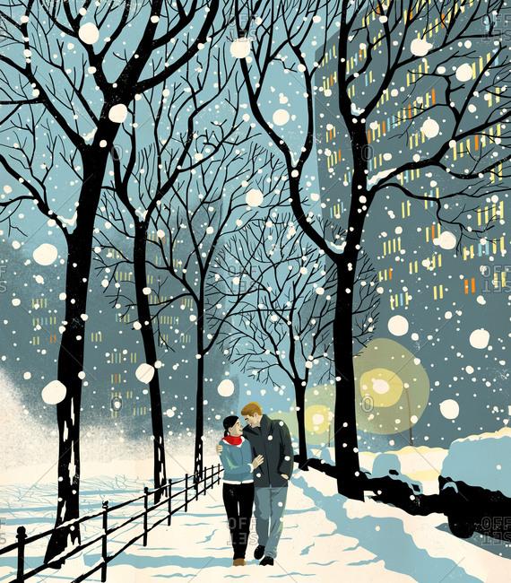 Couple walking in snowy city