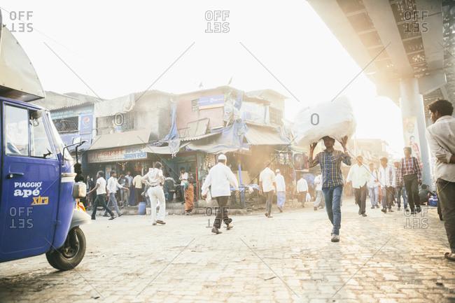 Mumbai, India - February 7, 2015: Crowded street in Mumbai neighborhood