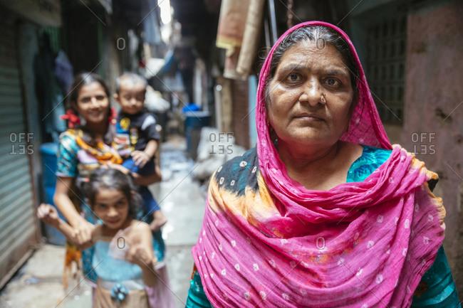 Mumbai, India - February 7, 2015: Women and children in Mumbai alley