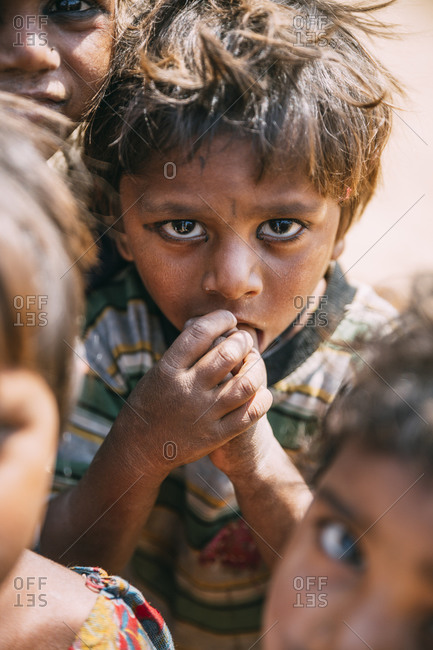 Pushkar, India - February 2, 2015: Indian boy surrounded by other children