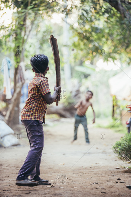 Alappuzha, India - January 28, 2015: Two young Indian boys playing with bat and ball