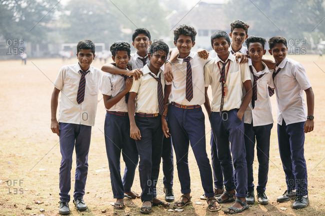 Kochi, India - January 30, 2015: Group of teen male students outside Indian school