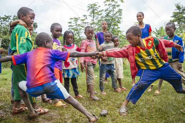 Mizan Tefere, Ethiopia - July 25, 2014: Two Ethiopian schoolchildren playing tug of war