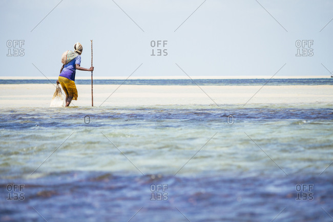 Woman in Mozambique hunting for crabs