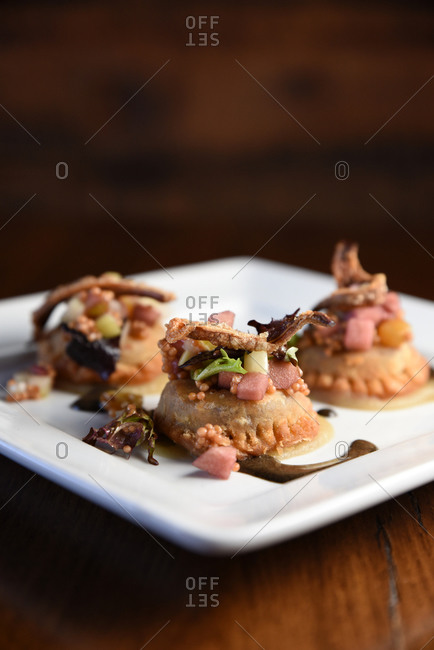 Square white plate of three savory appetizers